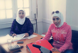 Huda (right) sits at a UNFPA-supported safe space in Alexandria, Egypt. She fled the violence in Syria three years ago and struggled to support herself. Now, she is working on behalf of other women refugees. Photo courtesy of Huda.