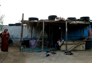 Syrian refugees in front of the tent where Haneen and her family previously lived in southern Lebanon. © UNFPA/David Brunetti