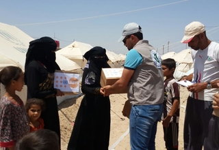 UNFPA mobile team distributing dignity kits to women and girls in Al-Iraq camp, Anbar governorate, Central Iraq