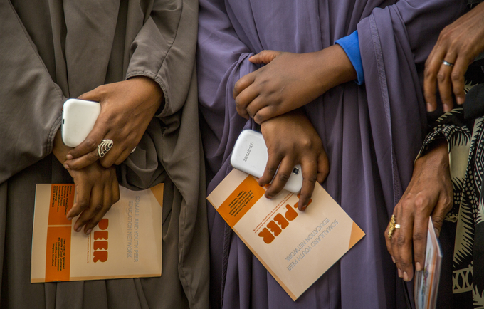 Y-PEER students at Muslim College in Hargeisa, Somaliland with pamphlets put together by Y-PEER, MOLSA and UNFPA giving guidelines on FGM advocacy.