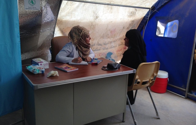 Consultation session at the UNFPA-supported reproductive health clinic in Kilo 18 Camp, Amryiat Al-Falujah, Central Iraq.