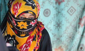 A survivor of gender-based violence was photographed at a displacement camp in 2011