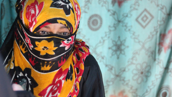 A survivor of gender-based violence (GBV) receives help at a UNFPA-supported clinic in a displacement camp in Hardh, Yemen.